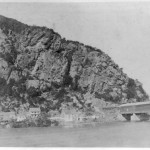 The base of Maryland Heights across from Harpers Ferry, and the covered railroad bridge, in 1859 (Library of Congress)