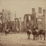People survey the ruins of the Bank of Chambersburg and Franklin House in Chambersburg, destroyed by Confederates under Brig. Gen. John McCausland (1864, R. Newell, photographer; Library of Congress)