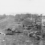 Confederate dead line the length of a fence on the Hagerstown road (September 1862, Alexander Gardner, photographer; Library of Congress)