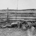 Soldiers of Stonewall Jackson's brigade are piled against a rail fence on the Hagerstown pike (September 1862, Alexander Gardner, photographer; Library of Congress)
