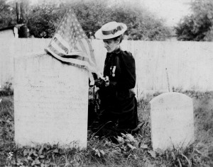 Mary Shellman placing a flag and flowers on the grave of a Union soldier in Westminster, c.1890  (Historical Society of Carroll County)