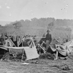 Dr. Anson Hurd, of the 14th Indiana Volunteers, attends to convalescing Confederate wounded troops in tents set up as a field hospital near Keedysville, Maryland (September 1862, Alexander Gardner, photographer; Library of Congress)