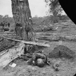 An unburied Confederate soldier next to the marked grave of a Union soldier (September 1862, Alexander Gardner, photographer; Library of Congress)