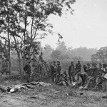 A group of Union soldiers armed with shovels and picks prepare to dig graves for Confederate soldiers (September 1862, Alexander Gardner, photographer; Library of Congress)