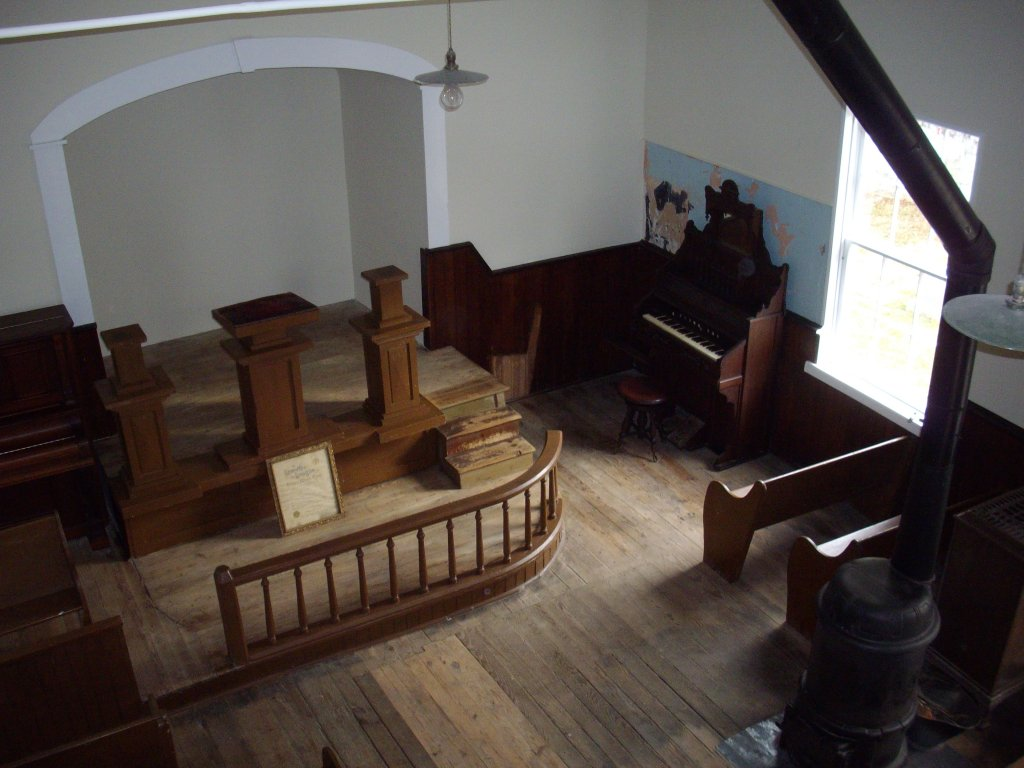 """Interior of Tolson's Chapel in 2012; the original """"liquid slate"""" paint for a blackboard is visible to the left of the organ  (Edie Wallace)"""