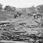 Onlookers view the bodies of Confederate soldiers in the Bloody Lane (September 1862, Alexander Gardner, photographer; Library of Congress)