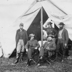 """Allan Pinkerton, head of the Union Army's """"secret service"""" in 1861-62, is seated on the right in this photograph taken after the Battle of Antietam. The others are George H. Bangs, R. William Moore, John C. Babcock, and Augustus K. Littlefield. (Alexander Gardner, photographer, October 1862; Library of Congress)"""