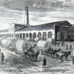 Lines of wagons wait outside the former U.S. armory, now used to store military supplies (A. R. Waud, artist; Harpers Weekly, March 11, 1865; NPS History Collection)