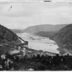 A photograph of lower town Harpers Ferry in 1865, showing the reconstructed railroad bridge (1865, James Gardner, photographer; Library of Congress)