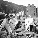 This image is part of a stereograph titled Contraband camp -- Harper's Ferry, Va. The scene was probably photographed in 1865, however, and post-Emancipation Proclamation, the term refugee camp is more accurate. (1865, John P. Soule, photographer; Library of Congress, courtesy of New-York Historical Society)