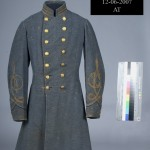 Confederate infantry officers gray frock coat with three gold stripes indicating the rank of Captain. Brass buttons are decorated with the Virginia state seal. (Gettysburg National Military Park)