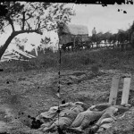 Wooden boards mark the mass grave of dead Confederate soldiers (July 1863, Timothy O'Sullivan, photographer; Library of Congress)