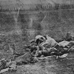 A group of dead soldiers lay heaped together on a battlefield hillside (September 1862, Alexander Gardner, photographer; Library of Congress)