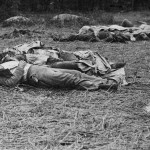 Near the center of the battlefield, Confederate soldiers remain in the same positions where they were killed (July 1863, Alexander Gardner, photographer; Library of Congress)