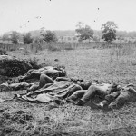 A row of Confederate corpses (July 1863, Timothy O'Sullivan, photographer; Library of Congress)