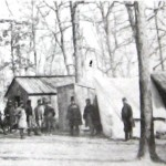 Camp of the 13th Massachusetts near Williamsport; the small building behind the man in the top hat is the camp's library (U.S. Army Military History Institute)