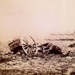 A dead mule remains tethered to a broken artillery caisson on the battlefield (July 1863; Library of Congress)