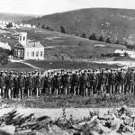 Soldiers of the 22nd New York State Militia on Camp Hill in August 1862, with St. Johns Lutheran Church in the background (Harpers Ferry National Historical Park)