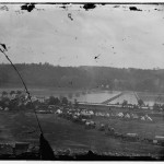 Berlin (now Brunswick), Maryland, showing the ruins of a bridge, two pontoon bridges, and elements of Union General Ambrose Burnside's army preparing to cross the Potomac River (Alexander Gardner, photographer, October 1862; Library of Congress)