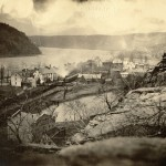 A train holding Union soldiers passes across Virginius Island in this photographer taken from Jefferson Rock c.1864 (Bowlsby, photographer; United States Military Academy, West Point)