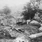 "Dead Confederate soldiers remain where they were slain in the ""slaughter pen"" at the foot of Little Round Top (July 1863, Alexander Gardner, photographer; Library of Congress)"