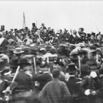A photograph of the dedication ceremony shows Abraham Lincoln in the center (November 19, 1863, Matthew Brady, photographer; Library of Congress)