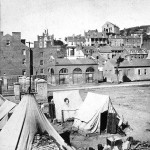Another view of the refugee camp. This image is part of a stereograph titled Harper's Ferry, from Railroad - contraband camp in foreground. As with the previous image, this scene was probably photographed in 1865, and post-Emancipation Proclamation, the term refugee camp is more accurate. (1865, John P. Soule, photographer; Library of Congress, courtesy of New-York Historical Society; the Library of Congress also has a different stereograph of this image, attributed to George Stacy)