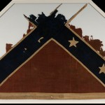 A portion of a Confederate flag belonging to one of the regiments of General George Picketts command. The flag was captured at the Battle of Five Forks, Virginia, on April 1, 1865 by Lt. Jacob Koogle of the 7th Maryland Infantry. Koogle, from Middletown, Maryland, received the Medal of Honor for capturing this flag. (Gettysburg National Military Park)
